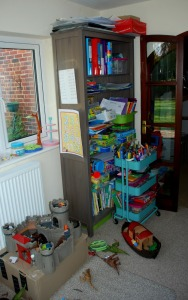 the-kids-play-area-with-another-bookcase-some-toys-and-their-art-cart