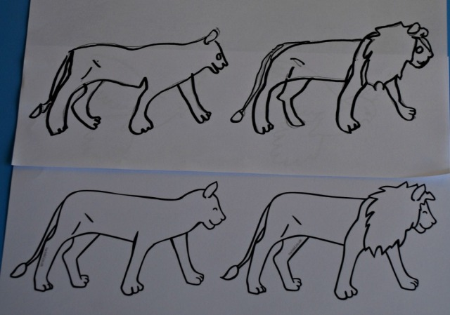 Tracing over the lion stick puppet templates to create a whole pride of lions
