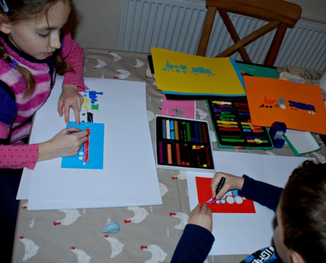 Easy art activity for younger kids using train stencils and oil pastels