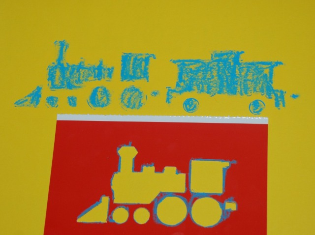 Fun with Trains Stencils. A blue train made with the stencils and some oil pastels