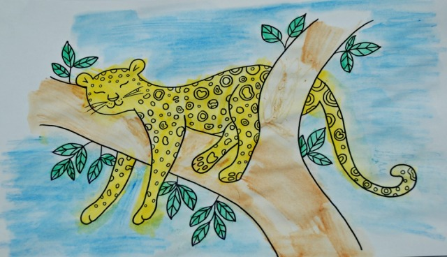 Leopard Mindulness colouring page completed using water-colour pencils
