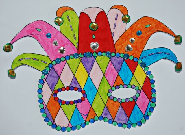 Mardi Gras colouring mask from Activity Village with some craft jewels added