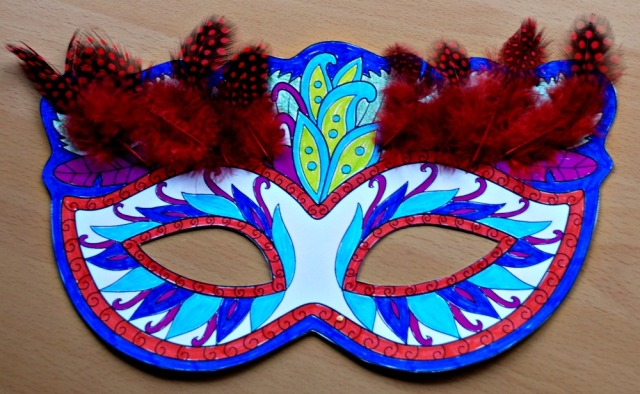 Mardi Gras colouring mask with some feathers added