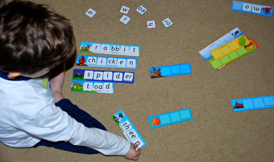 Practicing spelling word with the Orachrd Toys Match and Spell Next steps game