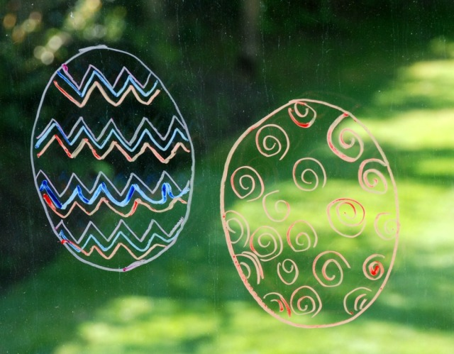 Easter Eggs traced onto our sliding doors using a Twinkl egg template