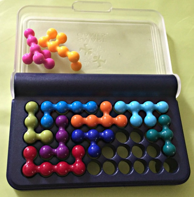 IQ fit a Smart Game which involves placing the 3D pieces into the empty holes in a manner which results in no holes been left open