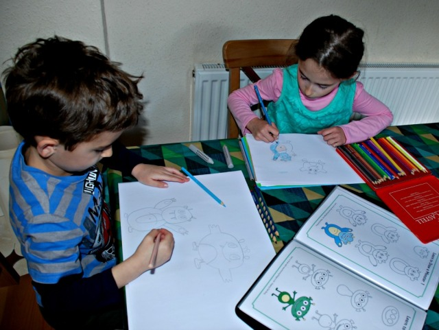 Using the How to Draw Monsters page out of the Home-made How to Draw book created using downloads from Activity Village