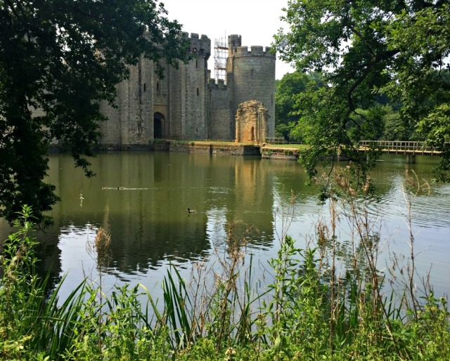 Bodiam Castle. You walk around the moat and then enter on the wooden bridge through the gatehouse