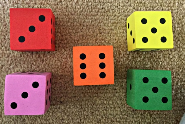 Using foam dice to help kids with sums where they need to regroup the numbers