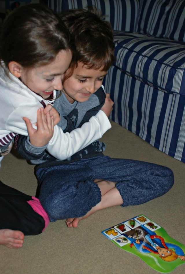 Playing Magic Maths by Orchard Toys. The player who fills their board with the ingredients is the winner