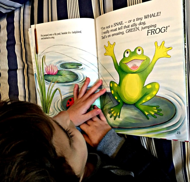 Reading Tad's Tale. A lovely children's fictional story about a tadpole who is sad until be becomes a frog