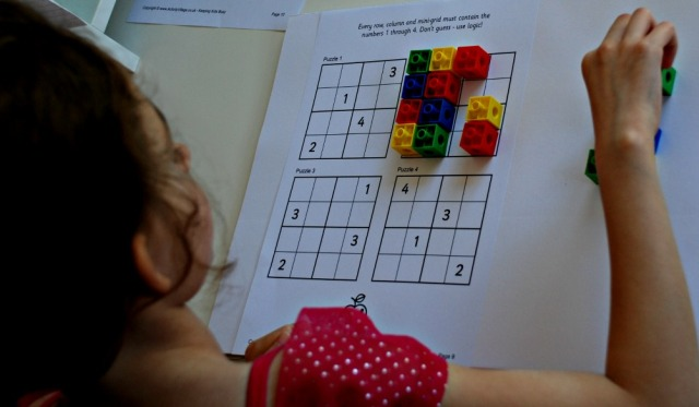 Practicing Sudoku using snap cubes to create a colourful pattern