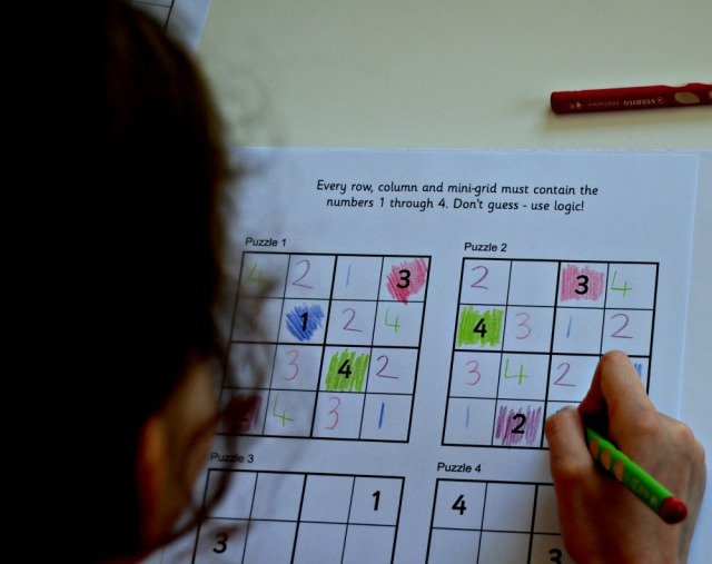 Solving the Activity Village sudoku puzzles by using coloured pencils to help create a pattern