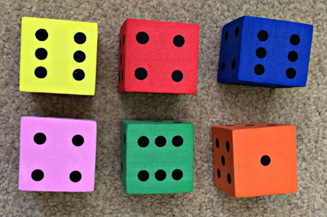Using Foam dice to help the kids practice regrouping numbers within a sum to make it easier to solve