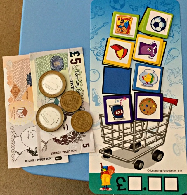 Buy It Right Game from Learning Resources. The children need to fill the shopping cart by buying item cards with the money they have