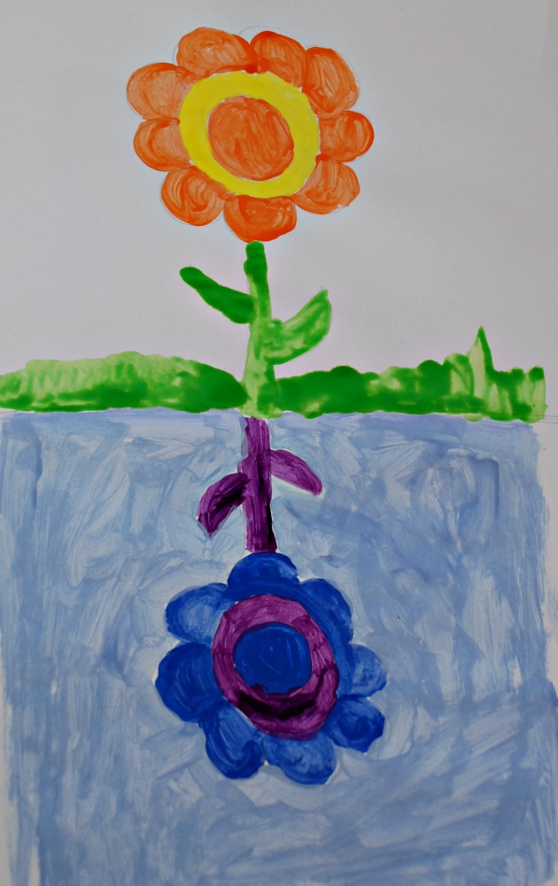Using complementary colours in the reflection of a flower. Fun painting project for young kids