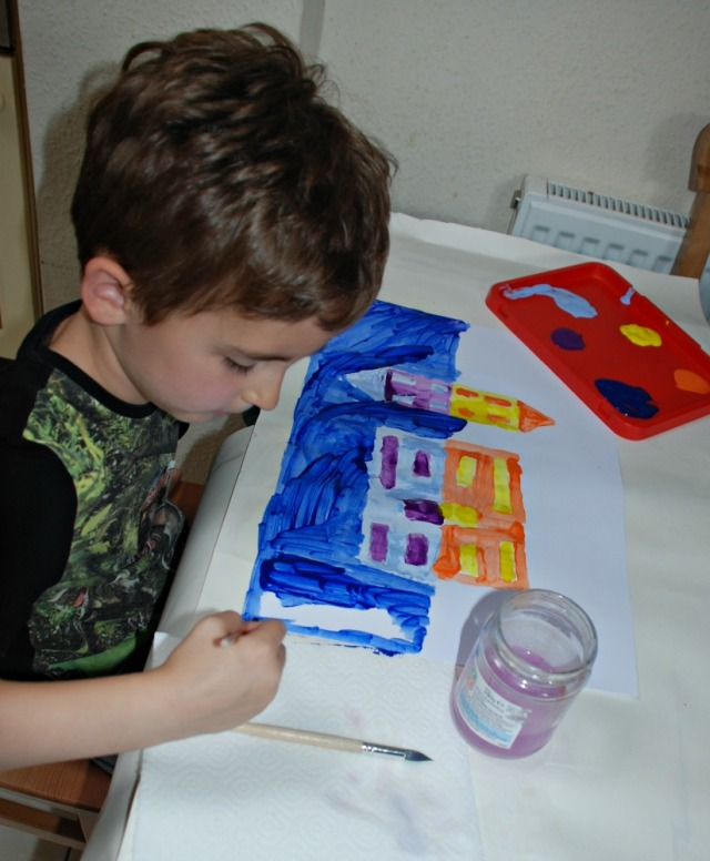 Using Complementary colours to paint the reflections of building in a lake. Fun, easy art project for children