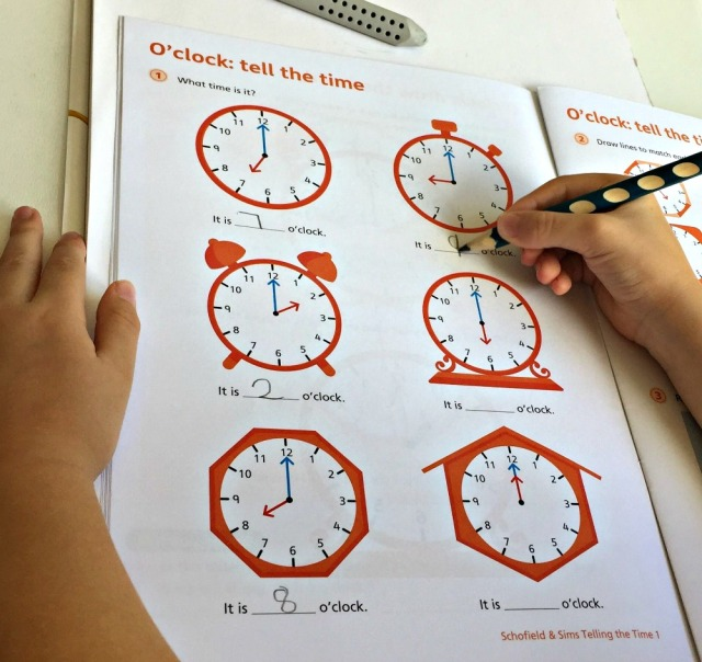 Telling the Time 1 by Schofield & Sims contains lots of examples to practice telling the time for o'clock, half past, quarter past and quarter to