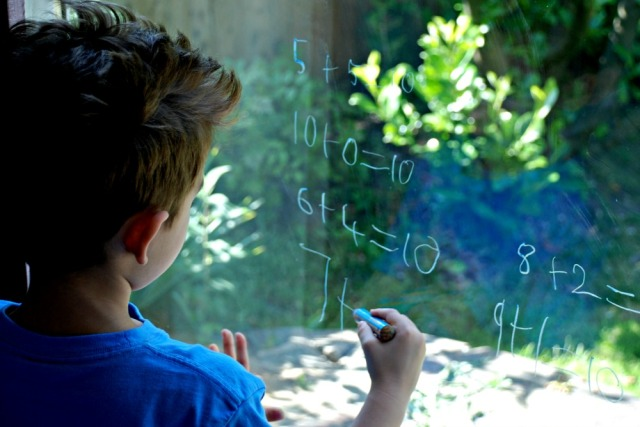 Maths on our sliding doors using our STABILO 3-in-1 pencils. A fun way for the kids to practice maths at home
