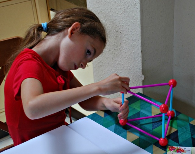 Helping kids to draw 3D shapes, first they build the shape using their Dive Into Shapes set