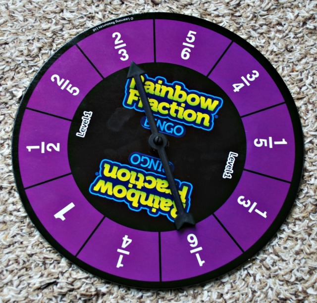 Rainbow Fraction Bingo game from Learning Resources comes with a double sided spinner
