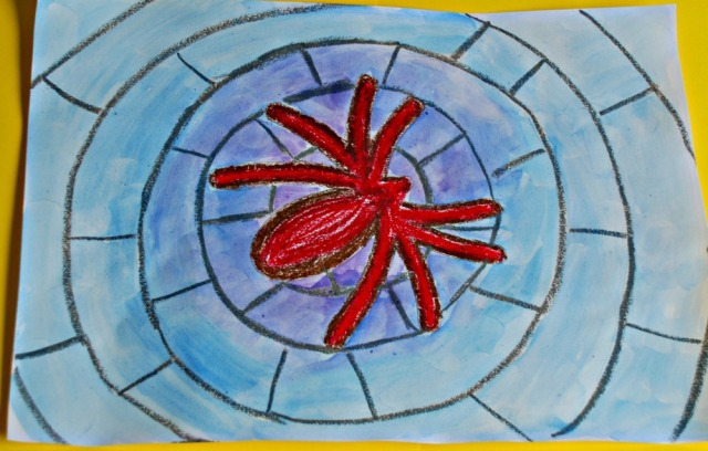 Children's spider picture made using a spider template, oil pastels and watercolour paints