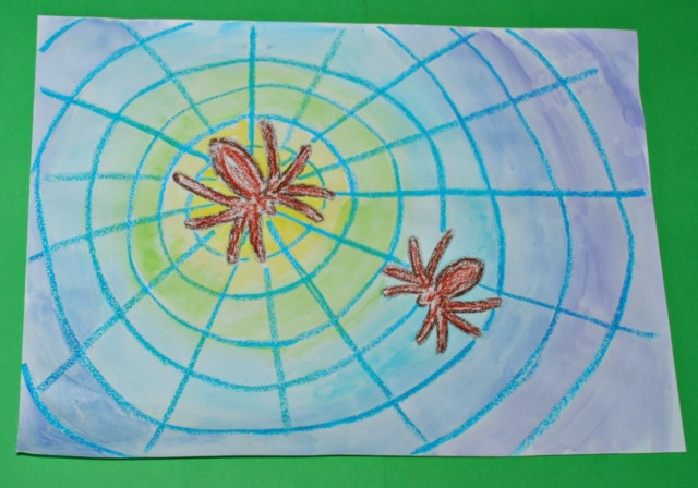 Spider picture with oil pastels and watercolours using different coloured background