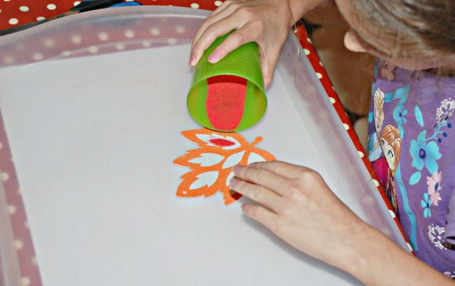 Sand Art. Get the kids to work over big trays to prevent the sand from going everywhere