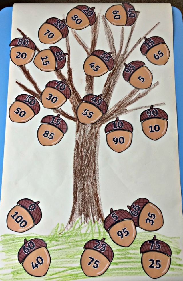 Acorn Number Bond Tree created by the kids. The acorns are printed out from Twinkl Resources