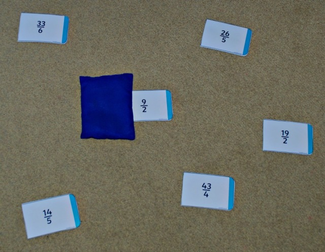 Improper Fraction Bean Bag game. Fun way to practice converting Improper fractions into Mixed Fractions