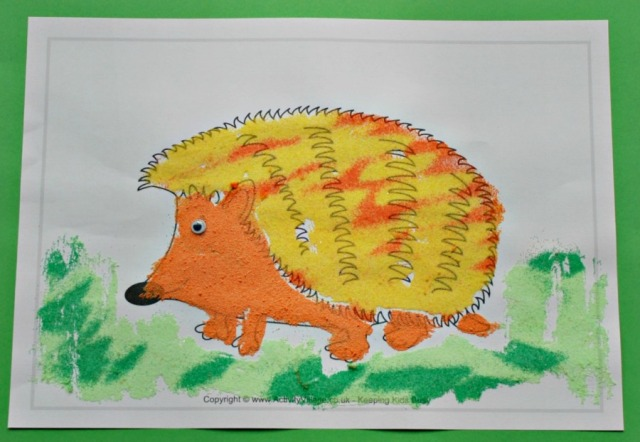 A Sand Art Hedgehog made using an Activity Village colouring page, coloured sand and glue