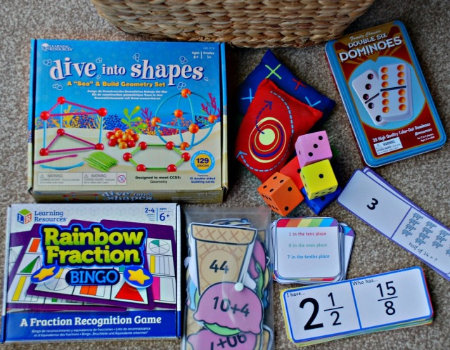 Maths Basket. Including Rainbow Fraction Bingo game, Dive into Shapes, Loop cards, matching cards from Twinkl. Dice and bean bags