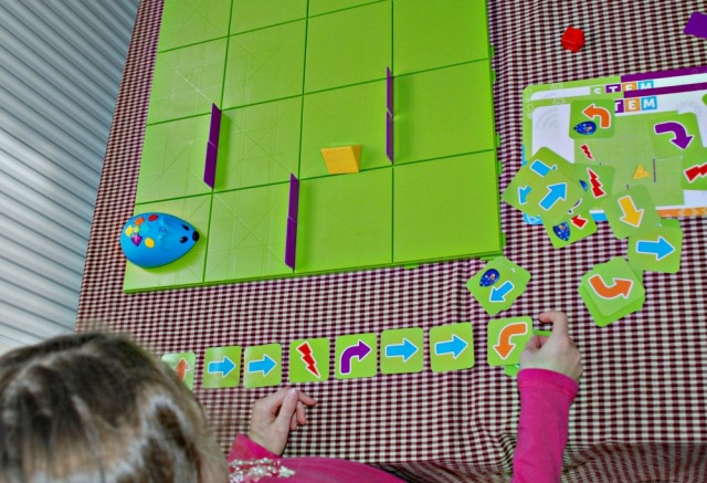 Code & Go Robot Mouse Activity Set. Using the programming cards to help map out the route