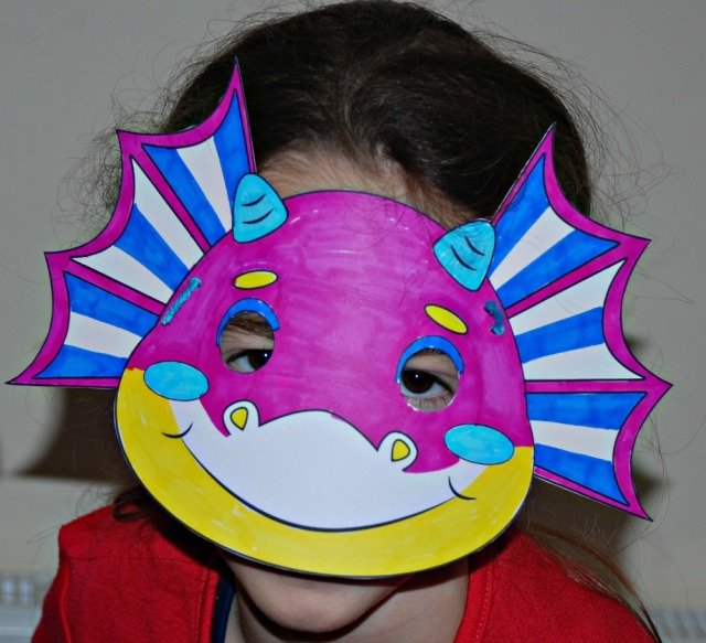Colourful dragon mask. Black and white template downloaded from Activity Village and decorated by the kids