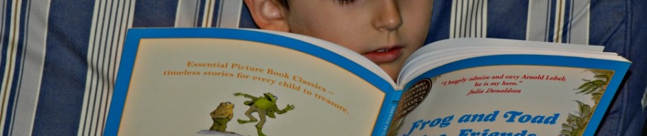 Reading Frog and Toad by Arnold Lobel to himself. A story book which becomes a good reader
