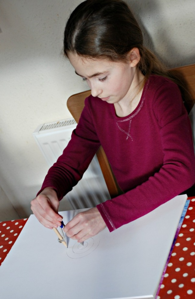 Creating for own geometry art picture using her Maths geometry Set
