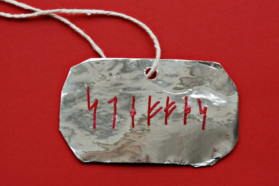 Viking Rune necklace made by kids after reading the How to Train Your Dragon series