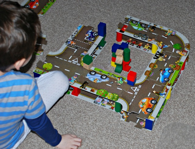 building with his giant road floor puzzles
