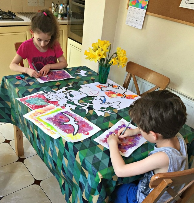 tracing around the templates to create some colourful pictures