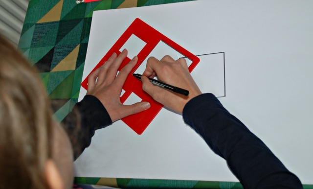 Using our Learning Resources shape stencils to draw an angle picture