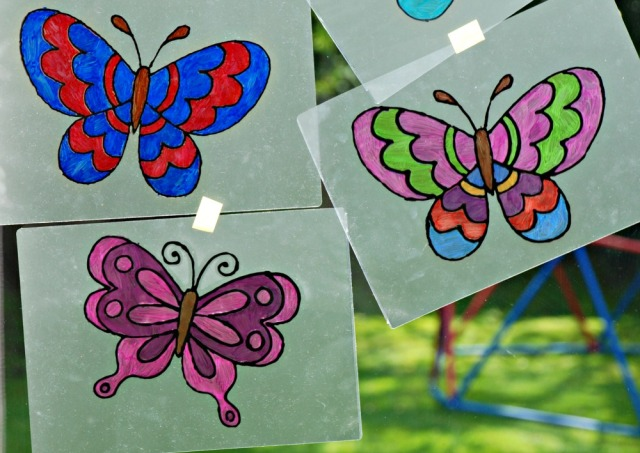 Using butterfly colouring pages to create window art