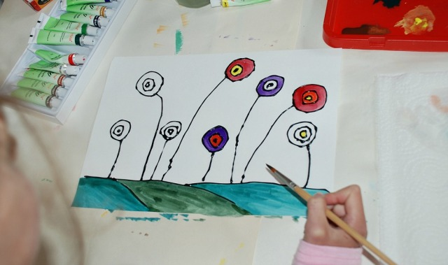 Adding watercolours to our circular flower pictures