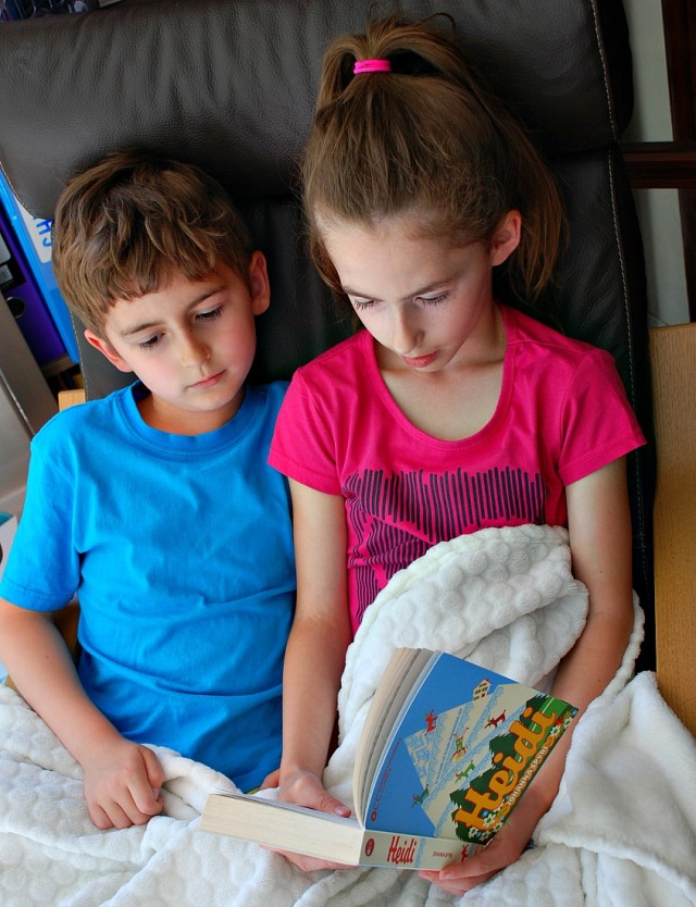 Siblings reading together. Reading Heidi