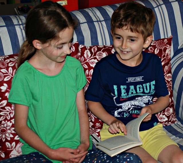 Siblings reading aloud together