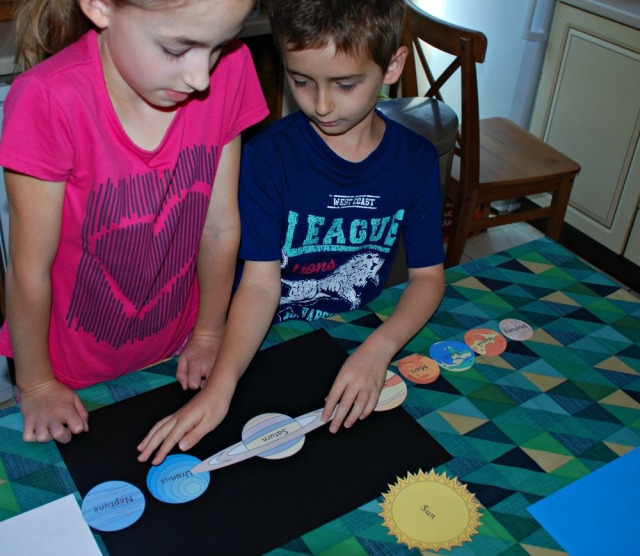 Using the Planet cut-outs from Activity Village to create a Planet poster