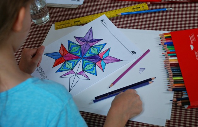 Using the Rangoli Pattern colouring pages from Twinkl to work on lines of symmetry