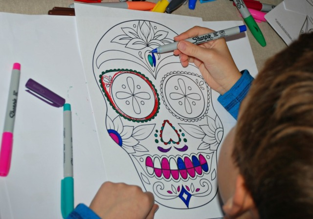 Colouring in a Day of the Dead page from Activity Village