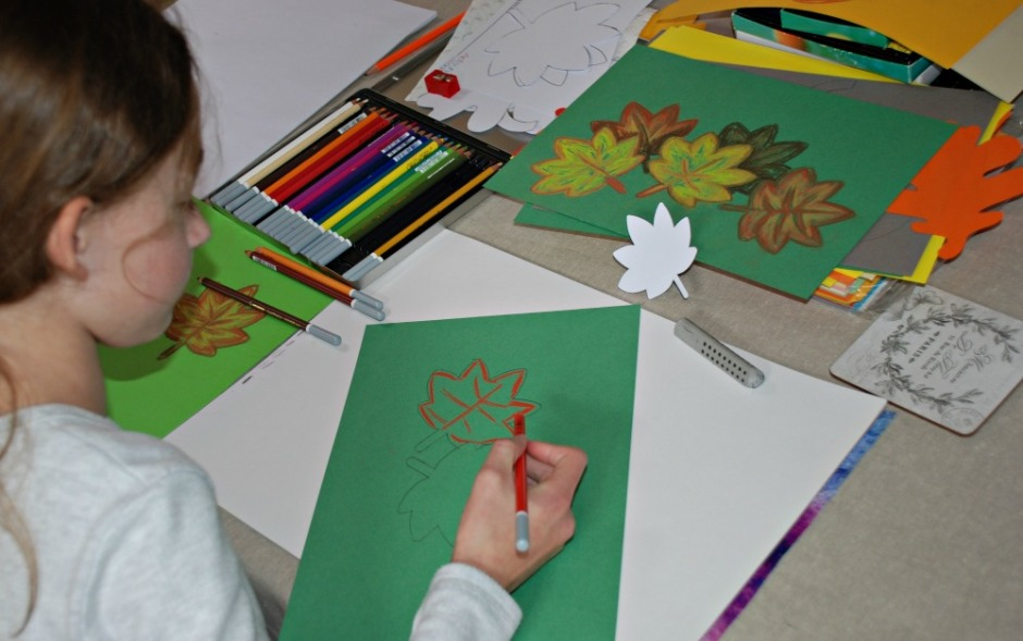 working on her autumn leaf pictures using her chalk pastels