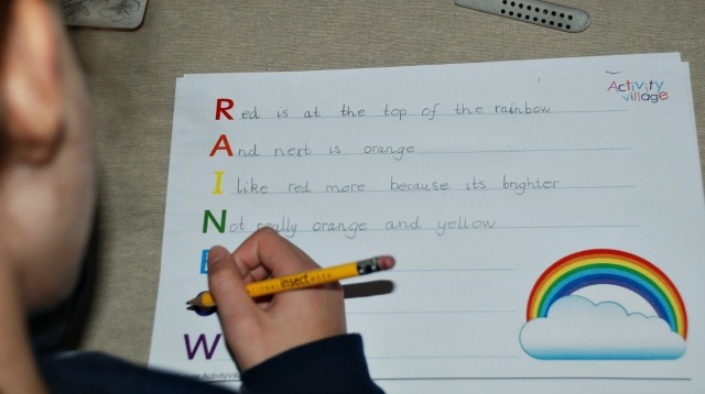writing a Rainbow Acrostic poem using the a rainbow page from Activity Village
