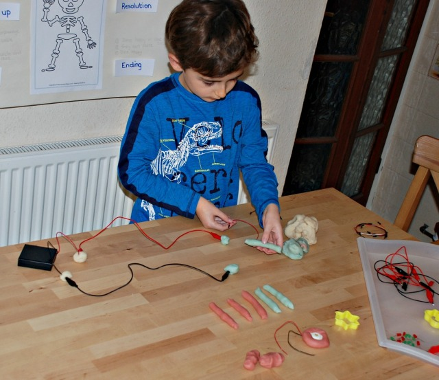 Creating circuits with his DIY Electro Dough Kit